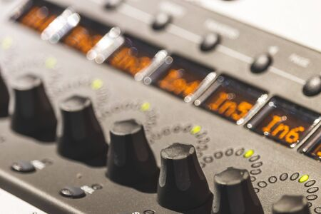 audio mixing console knobs, close up