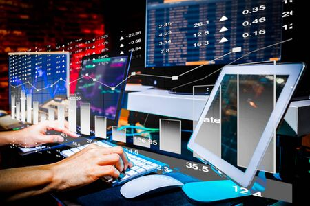 Businessman trading stocks with desktop, laptop and tablet computer