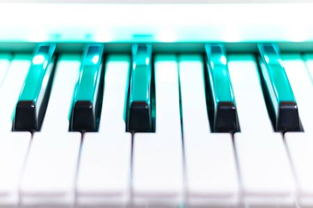 close up piano keys. shallow dept of field. music background