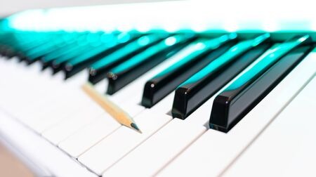 pencil on piano keys. shallow dept of field. song writing concept Stockfoto