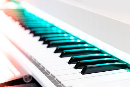 pencil on piano keys. shallow dept of field. music background