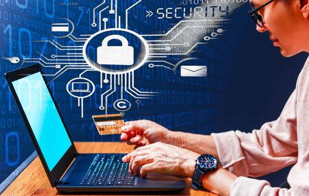 online shopping security concept. man use credit card for online shopping on laptop computer