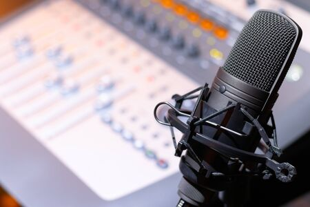 microphone on mixing console background. recording concept