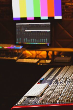 audio mixing console in recording studio. recording, broadcasting, post production concept Stock Photo