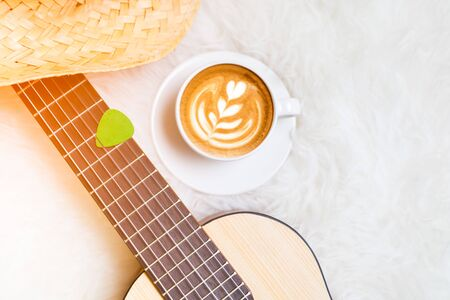 cup of coffee and acoustic guitar on white in the morning Stock Photo