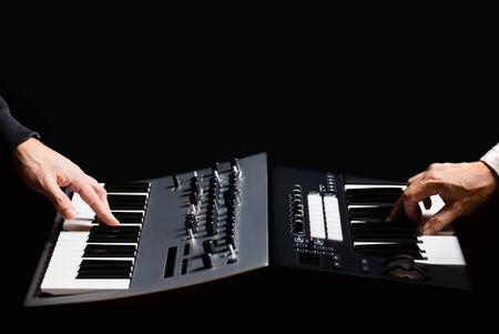 real hardware synthesizer jamming with virtual instrument plugins from midi keyboard controller Stock Photo