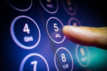 finger entering phone number or passcode on touchscreen numpad. communication, security technology concept