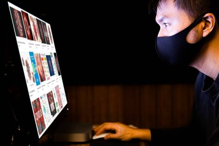Asian man searching for coronavirus information on internet