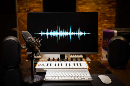 microphone and waveform on display. music production, broadcasting, live streaming concept