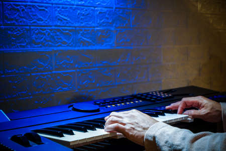 classical, keyboardist, song, sound, audio, practice, hobby, jazz, solo, melody, chord, playing, hands, pianist, copy space, background, instrument, musical, keyboard, keys, piano, musician, male, man Standard-Bild