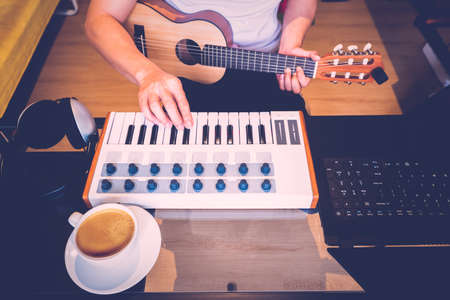 man learning online music lesson from internet