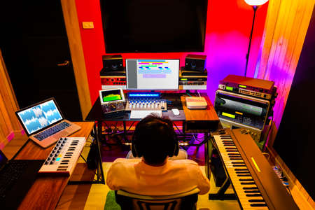modern home recording studio showing professional digital audio recording equipment for music production, post production and voiceover acting