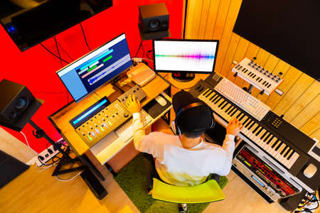 top view of professional music producer arranging, mixing a song in sound studio