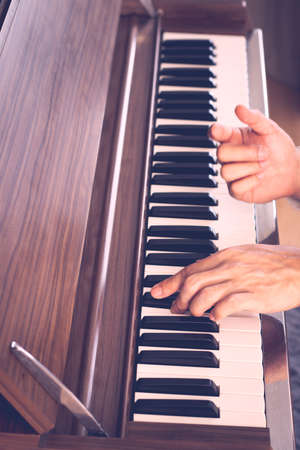 male professional pianist hands playing on piano keys