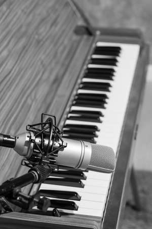 condenser microphone on piano background