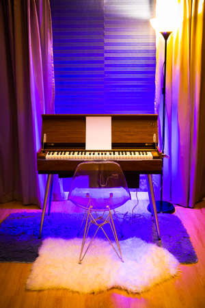 rare vintage reed organ in modern living room with colorful ambient light setting Foto de archivo