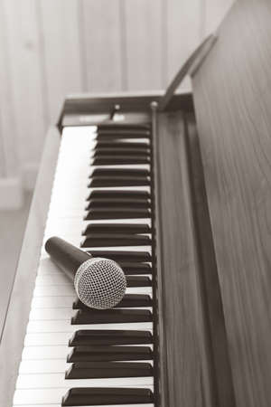 dynamic microphone on acoustic piano. music background