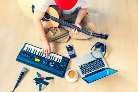 male musician, artist streaming his live concert at home Foto de archivo