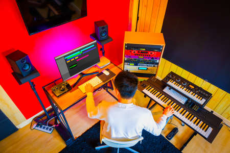 top view of asian male music producer arranging a hit song in home studio Foto de archivo