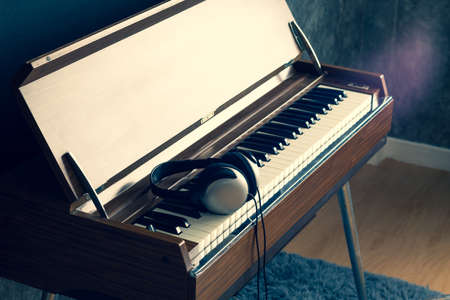 headphone on vintage organ keys in living room