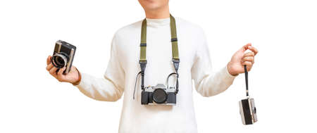 man in white t-shirt holding rangefinder camera, compact camera and hanging DSLR camera on neck. isolate on white. photography concept