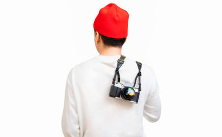 back of asian man holding DSLR camera on his back. photography concept