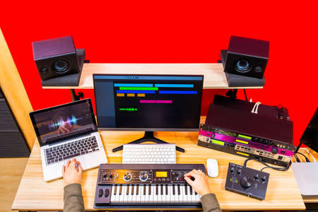 top view of professional music producer hands arranging a hit song in home recording studio. music production concept background Stock fotó