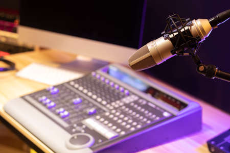 microphone, sound mixer, computer and professional sound equipment in studio. voice over or live broadcasting concept Imagens