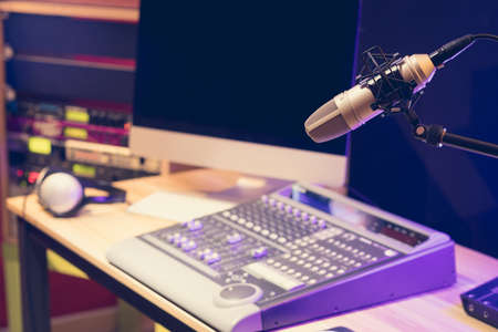 microphone, sound mixer, computer and professional sound equipment in studio. voice over or live broadcasting concept Stock fotó