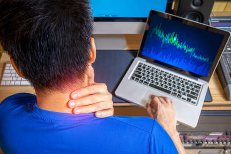 back of young business people are suffering from neck pain. Asian men stressful working with computer for a long time. office syndrome concept Stock fotó