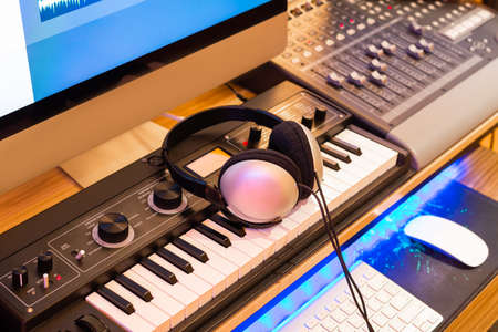 stereo headphone on keyboard synthesizer in home recording studio. music production equipment concept Stock fotó