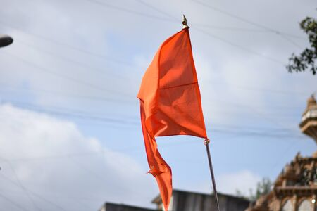 Saffron Religious Flag waving in Air Stock Photo