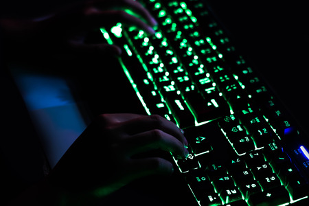 Playing computer game with gaming gear. Stock Photo