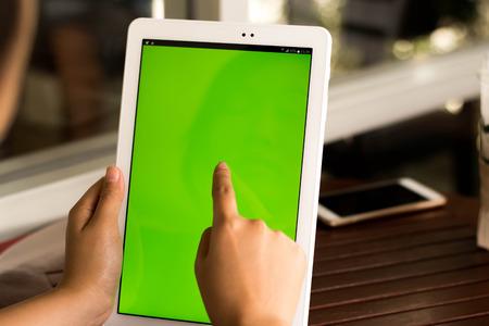 Close-up tablet met groen scherm. Stockfoto