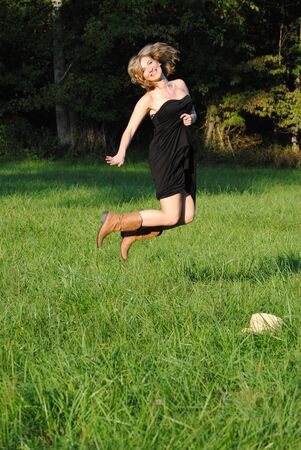 hay field: my beautiful daughter jumping in a hay field