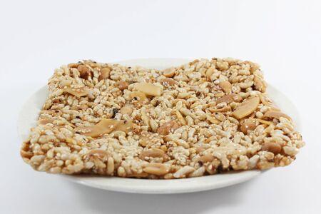 Krayasart, Thai sweet made of rice, nut, sesame-seeds and sugar on white background