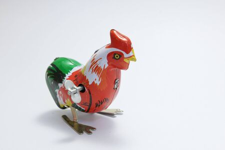 Thai vintage toys, colorful chicken made from zinc on white background