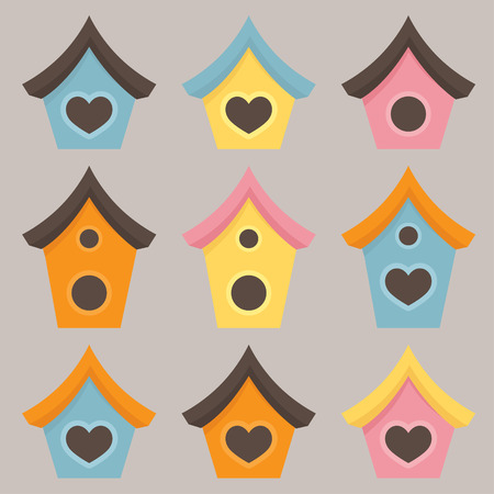 brightly: An assortment of brightly colored birdhouses.