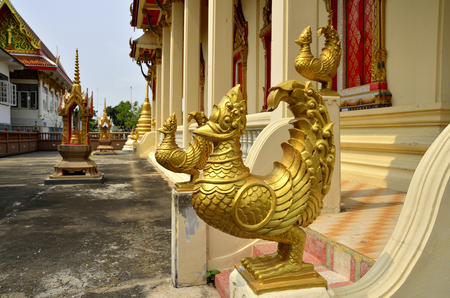 An golden bird unicorn in front of Thai church protecting their believe
