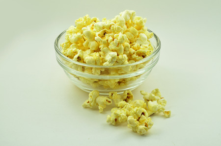 A bow of popcorn with butter in mind yellow tasty photo