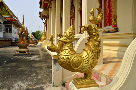 gardian: An golden bird unicorn in front of Thai church protecting their believe