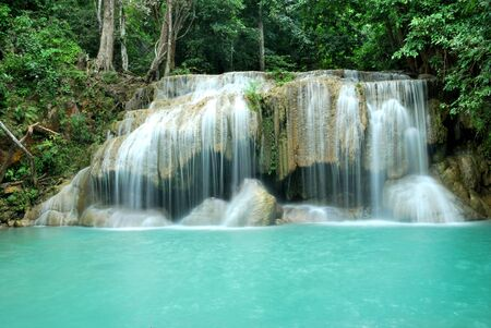 Erawan Waterfall, Karnchanaburi, Thailand, with water curtian and stream blue water pool