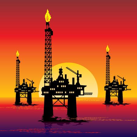petrochemistry: imagen de tres plataformas de petr�leo en el mar al atardecer