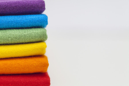 A stack of colourful shirts  Stockfoto
