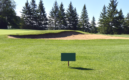Blank signage in front on the fairway and in front of green