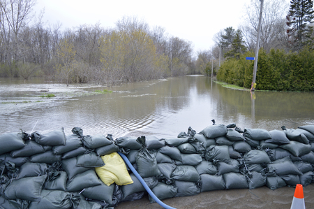 Sandbags protecting a home and neighbourhood Stock Photo