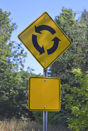 Image of a traffic circle warning sign, can be symbolic of life choice, decisions and reversals