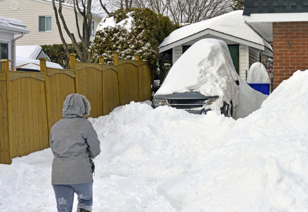 Car covered in snow after a huge Canadian snowfall in February