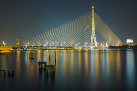 Rama VIII Bridge  is a cable-stayed bridge crossing the Chao Phraya River in Bangkok, Thailand. photo