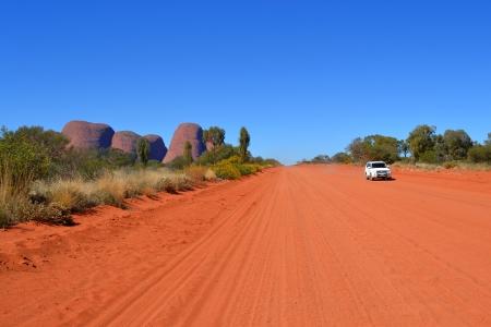 4wd: Car on red sand road near Kata Tjuta Editorial